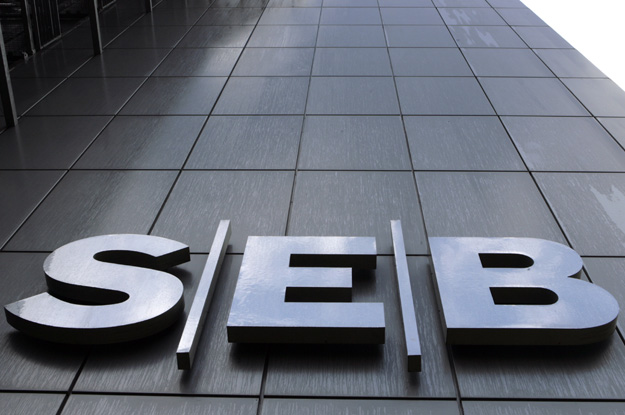 A SEB bank sign is seen on the bank's main office building in Riga